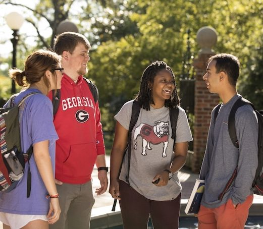 (L-R) Undergraduate students Sydney Ross, Greyson Roberts, Ashley Makala, and Abhyjit Kheepal talk with each other by the fountain at Owens Memorial Plaza.