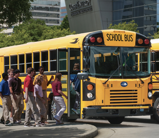 Students board a Blue Bird bus